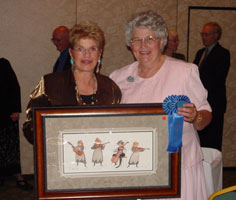 Pat and Judy with auction piece.